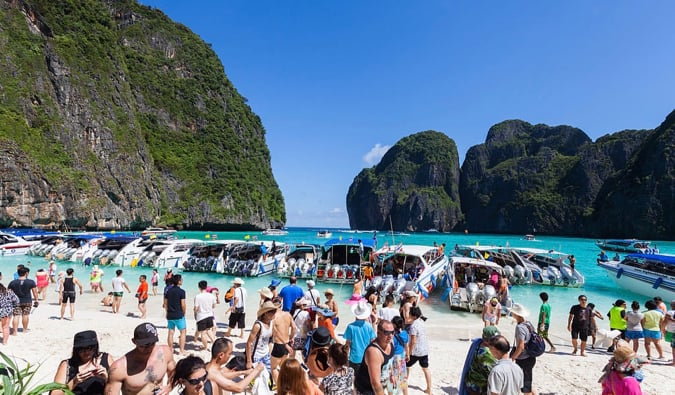 Lots of people on a crowded beach on Koh Phi Phi in Thailand