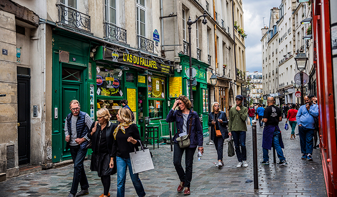 Locals wandering the streets of Le Marais in Paris, France