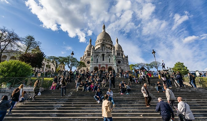 The famous stairs at Sacre Coeur filled with people in Montmartre, Paris