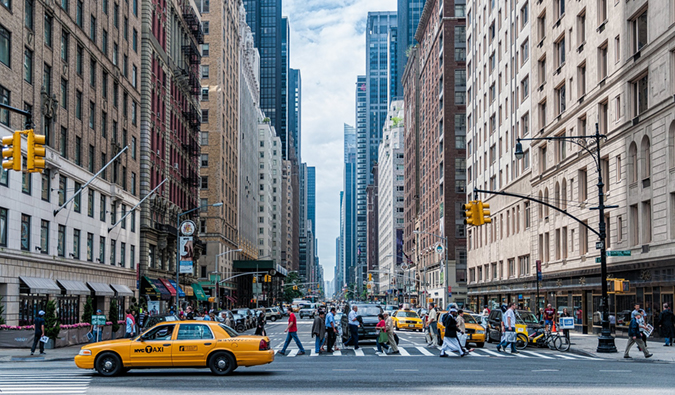 A busy intersection with a yellow cab in New York City