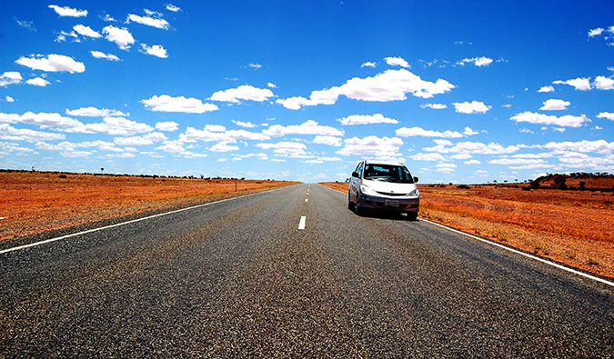 A car driving on the open road in Australia