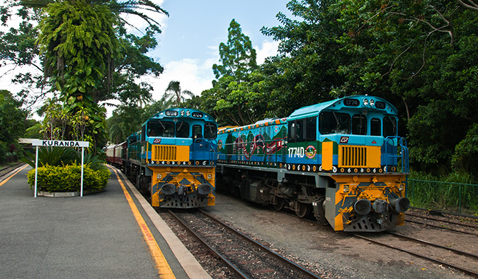 Two painted trains in Australia; Photo by Graeme Churchard (flickr:@graeme)