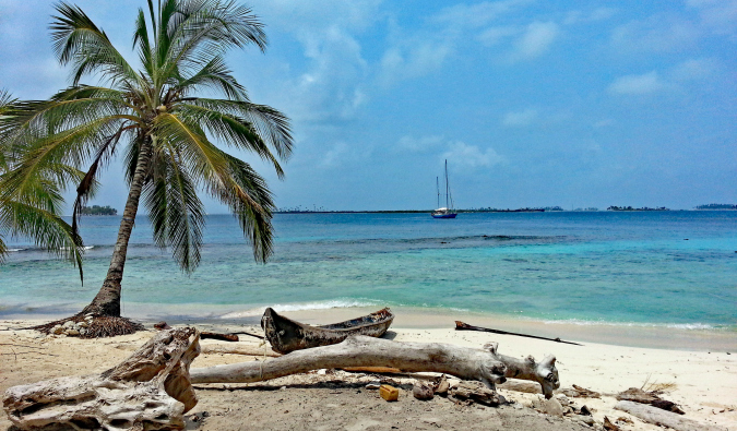 A secluded beach with a sailboat in Panama