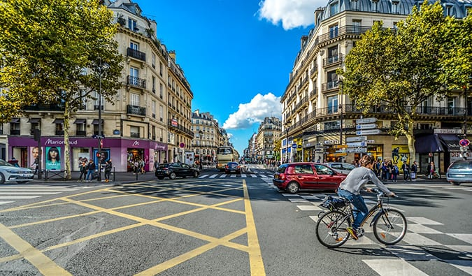 a person cycling through the streets of Paris