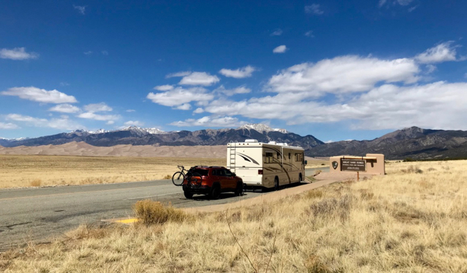 an RV for long-term travel parked on the side of the road
