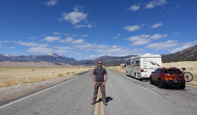 marc from RV Love standing in the road on a road trip
