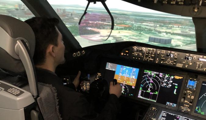 Nomadic Matt flying in a flight simulator
