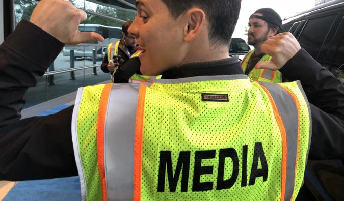 Nomadic Matt wearing a bright media vest