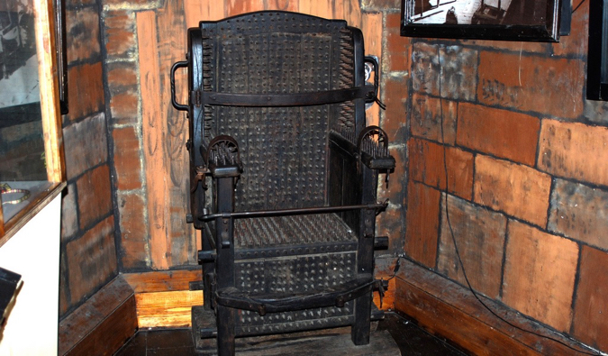 An old metal torture chair on display at the Torture Museum in Amsterdam