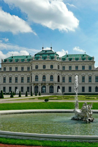 View of The Belvedere Palace in Vienna taken from the gardens by the pond and water feature