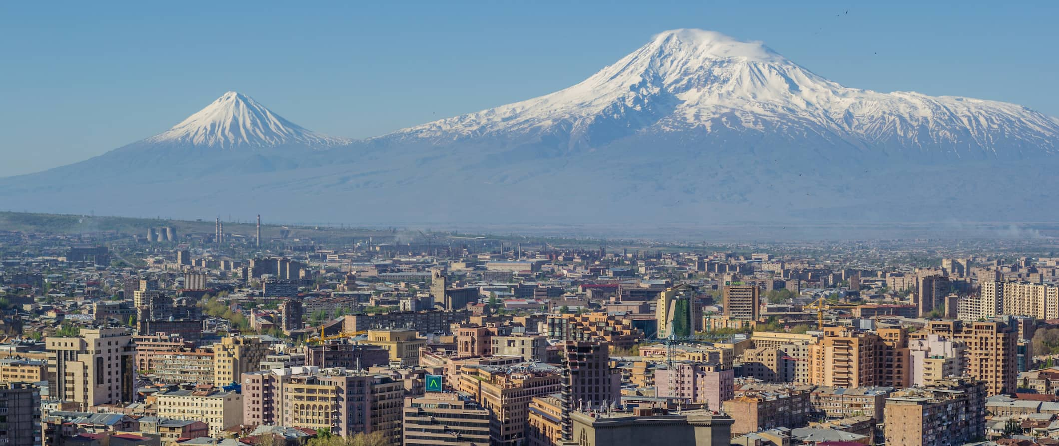 Mount Ararat and the Yerevan skyline. The Opera house is visible in the center - Image Serouj Ourishian
