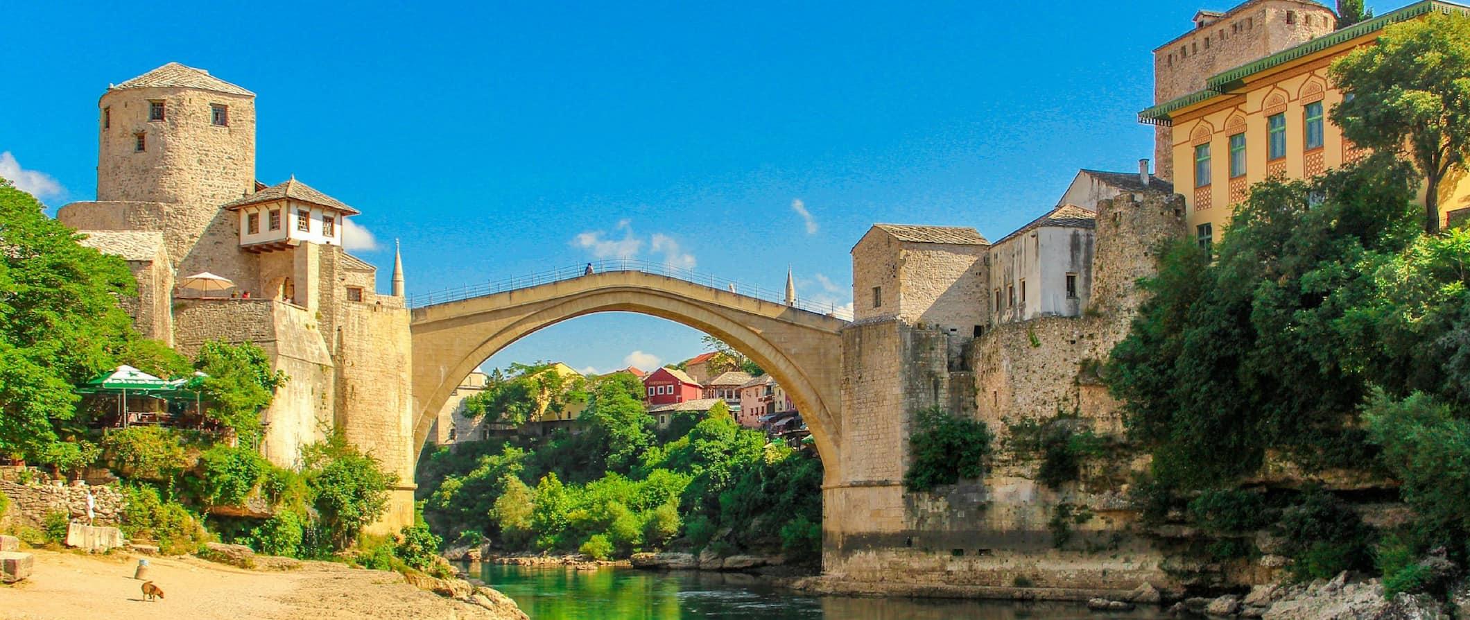 a view of a bridge across water in Bosnia & Herzegovina