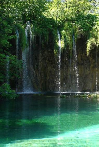 Waterfalls flowing into the Plitvice Lakes in Croatia