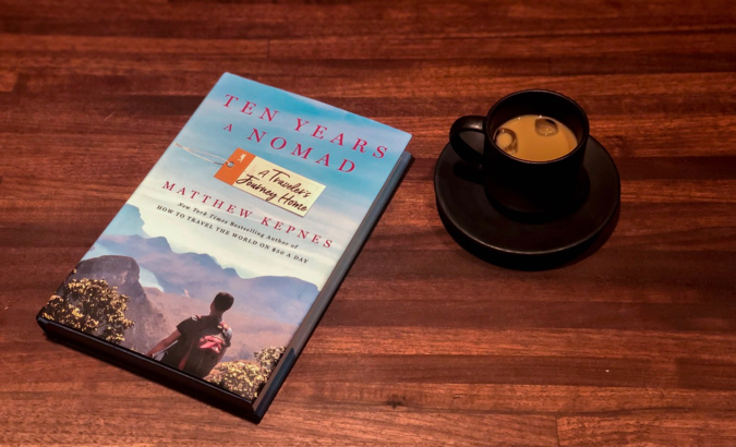 Ten Years a Nomad by Matt Kepnes on a table with a coffee