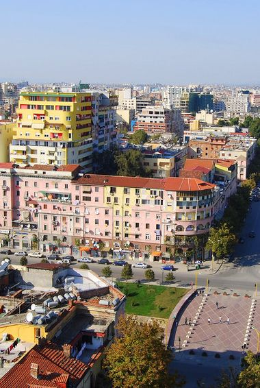 A colorful areal view of Tirana the Capital city of Albania. Photo by (Flickr: @Atilla2008)