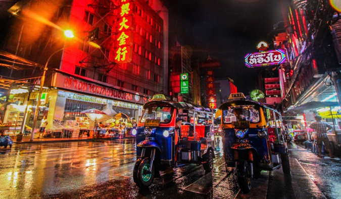 A bright shot at night of tuk-tuks in Southeast Asia
