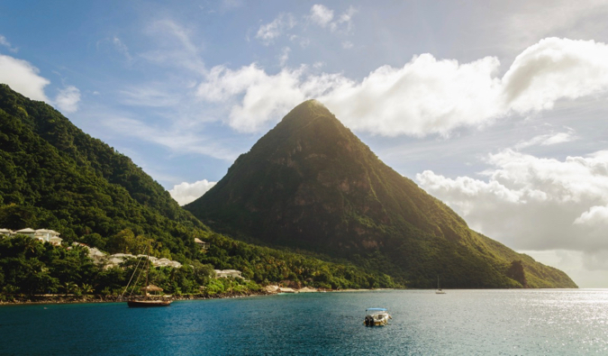 Beautiful blue water and a massive green hill in Saint Lucia