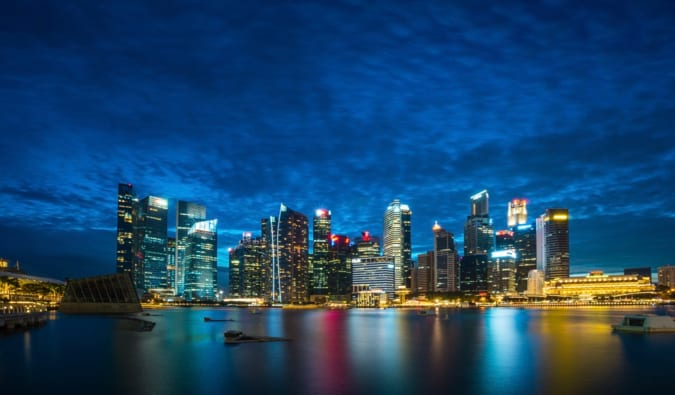the skyline of Singapore lit up at night
