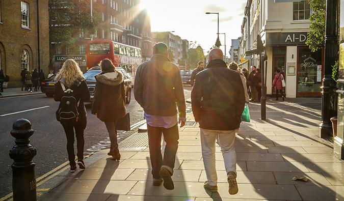 people in the sunlight walking through Chelsea; Photo by Matt Lowe (flickr:@matt_lowe1)