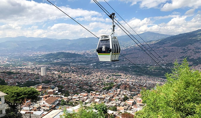 cable cars ascending into the hills over Medellín, Colombia