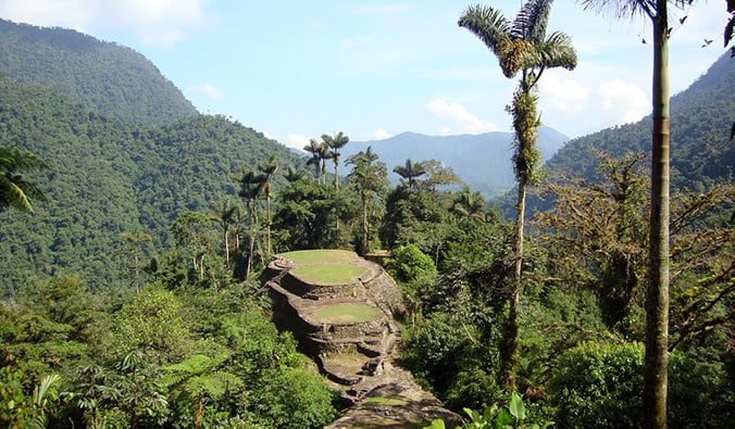 the La Ciudad Perdida trek in Colombia with terraces and stone steps; photo by Liam King (flickr:@liam-hels-big-trip)