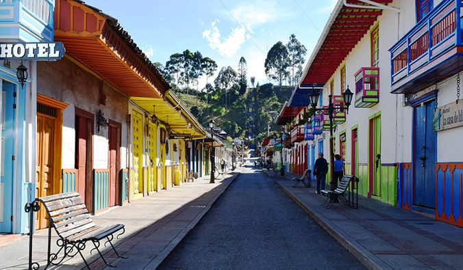 bright streets in Salento, Colombia with doors painted yellow, green, and blue