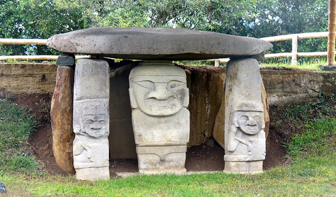 face carvings on a tomb in San Agustin Archaeological Park; photo by Erik Cleves Kristensen (flickr:@erikkristensen)
