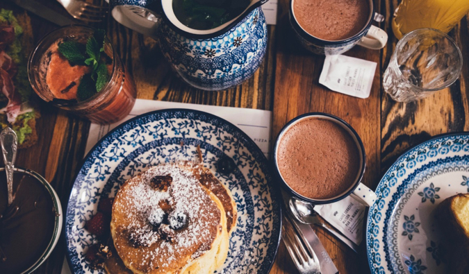a delicious pancake breakfast with berries and coffee