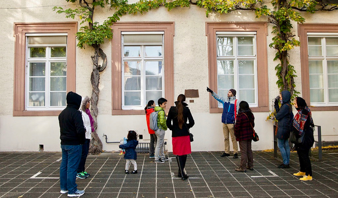 A man leading a walking tour group in Germany