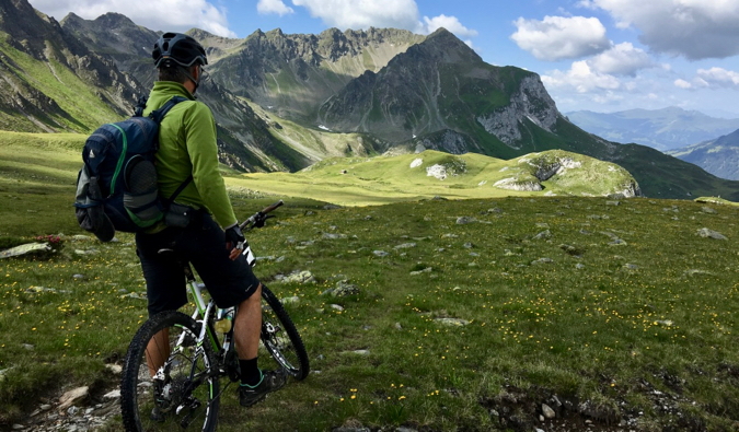 A man cycling through the mountains of Europe