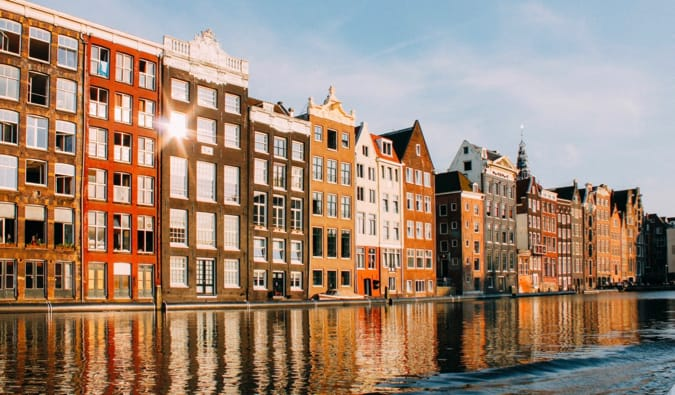 The historic buildings of Amsterdam that line the narrow canal