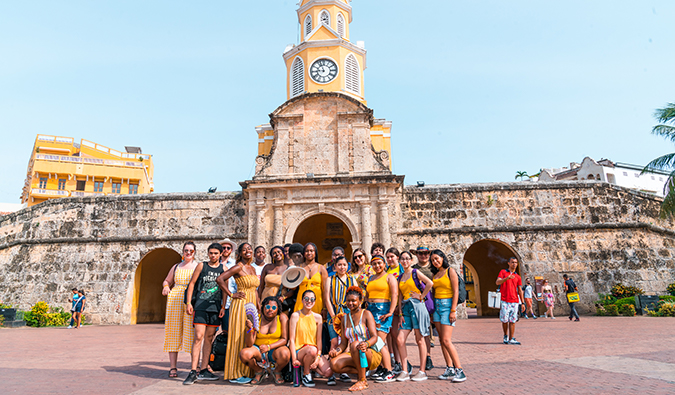 the FLYTE students on a field trip in Colombia standing in front of a yellow church