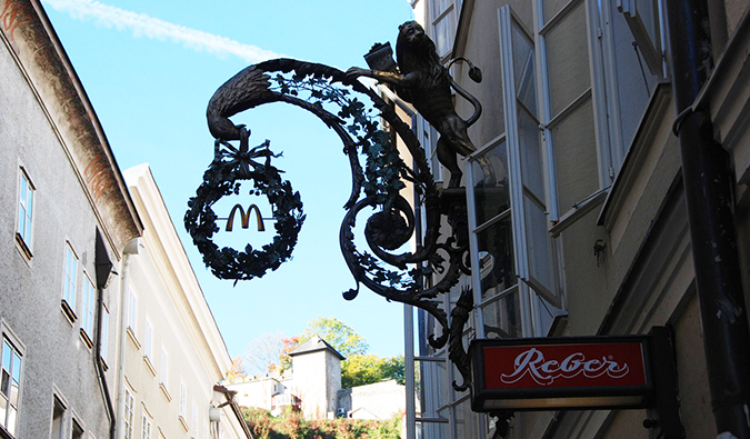a McDonald's sign in the streets of a tourist area