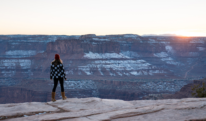 Kristin Addis standing in front of the Grand Canyon with some light snow