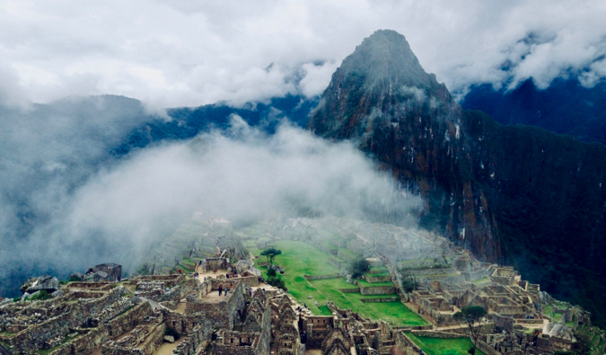 the sweeping vista of Machu Picchu in the fog
