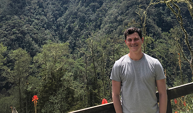 Matt Kepnes posing in front of a mountain in Colombia