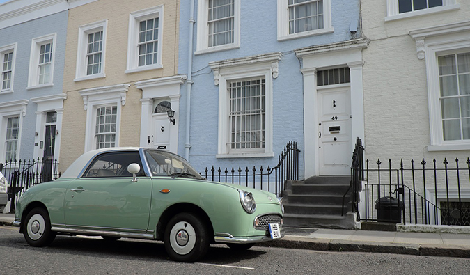 pastel colored homes with a vintage car in Notting Hill