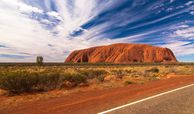 The famous Uluru rock in Australia, as seen from the nearby road