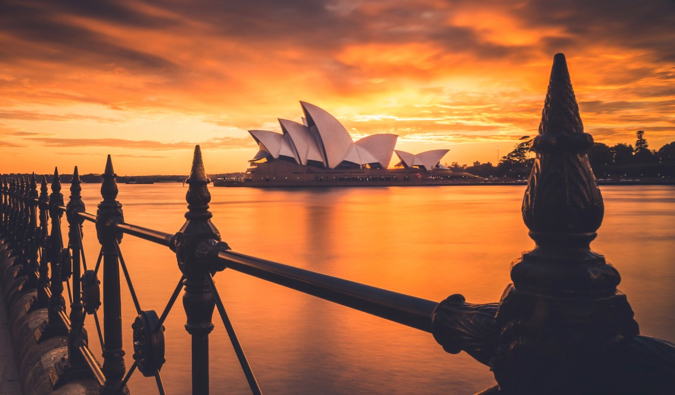 A vivid sunset photo of the Sydney Opera in Australia
