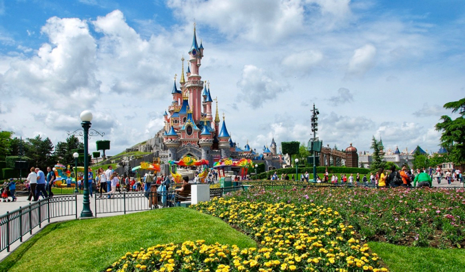 The picture-perfect castle at the heart of Disneyland Paris surrounded by flowers in France