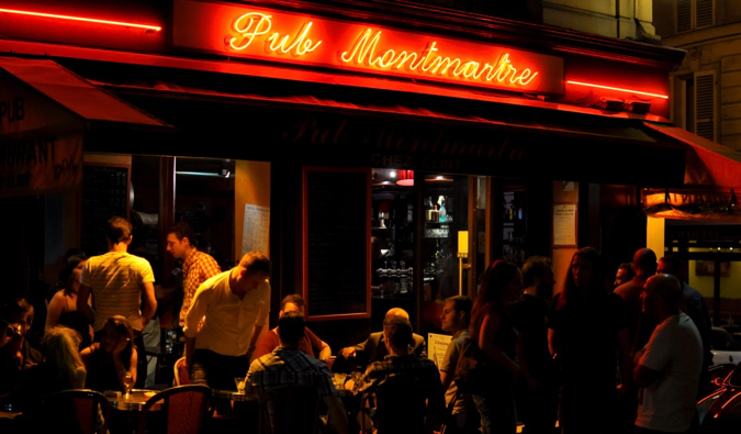 The patio of a busy bar a night in Paris, France