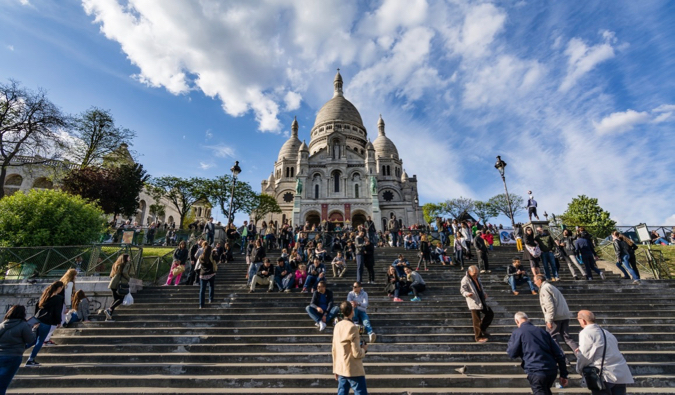 The crowded steps of Sacre Coeur atop Montmartre in Paris, France