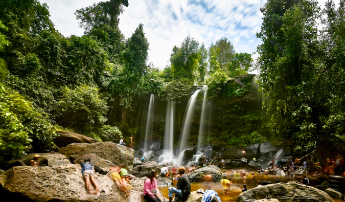 Locals and tourists bathing at the waterfall in Phnom Kulen national park
