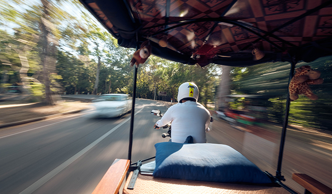 view from the back of a tuk tuk in Southeast Asia
