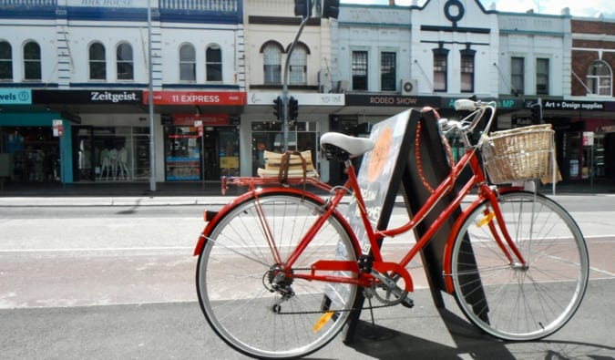 A red bicycle locked up on the street of Sydney's Paddington district
