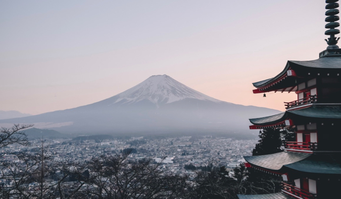 The view overlooking Mount Fuji in Japan with a temple in the foreground