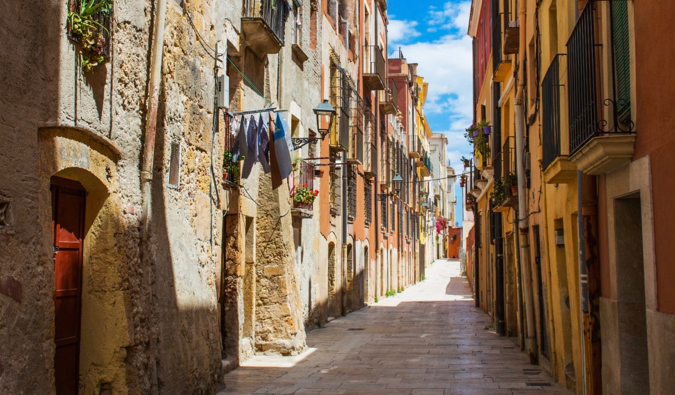 A narrow and winding alley in a traditional area of Cataluna, Spain