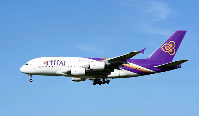 a Thai Airways plane taking off in Thailand
