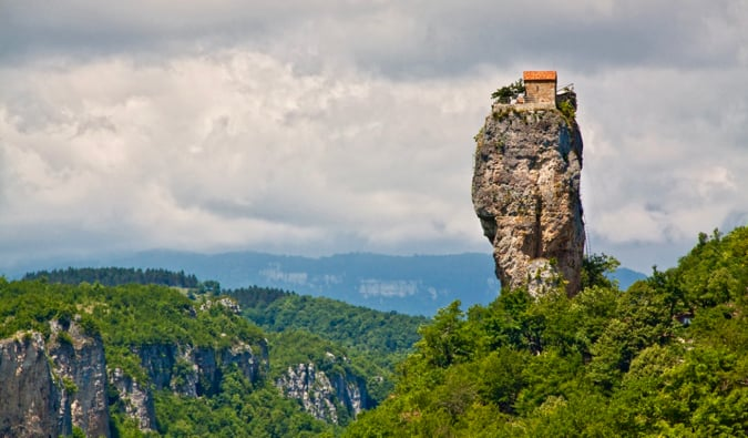 The famous Katskhi Pillar towering over the trees in Georgia
