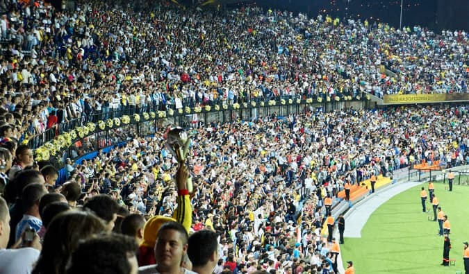 a packed stadium full of soccer fans in Medellin, Colombia